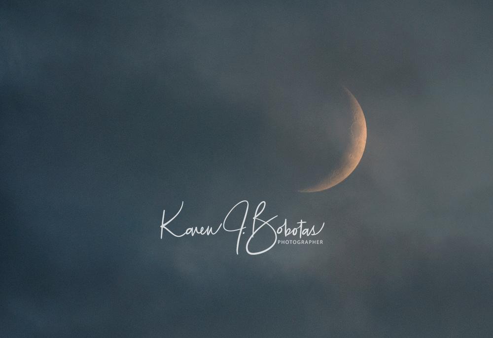 Crescent Moon in the clouds.  ©Karen Bobotas Photographer