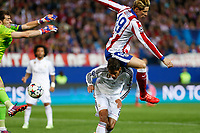 Atletico de Madrid's Fernando Torres (R) and Real Madrid´s Raphael Varane and Iker Casillas during quarterfinal first leg Champions League soccer match at Vicente Calderon stadium in Madrid, Spain. April 14, 2015. (ALTERPHOTOS/Victor Blanco)