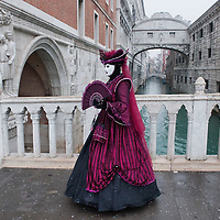 VENICE, ITALY - FEBRUARY 19:  A woman dressed with carnival costume walks in front of Ponte dei Sospiri (Bridge of Sighs) on February 19, 2012 in Venice, Italy.  The annual festival, which lasts nearly three weeks, will see the streets and canals of Venice filled with people wearing highly-decorative and imaginative carnival costumes and masks.  (Photo by Marco Secchi/Getty Images)