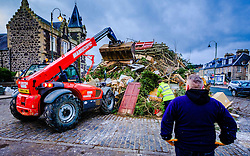 Biggar Scotland - 31st December 2016 <br /> Final preparations for the Biggar Hogmanay Bonfire which will be lit at 9.30pm tonight - hogmanay - 31st December. Probably the biggest hogmanay bonfire anywhere in Britain.<br /> <br /> (c) Andrew Wilson | Edinburgh Elite media