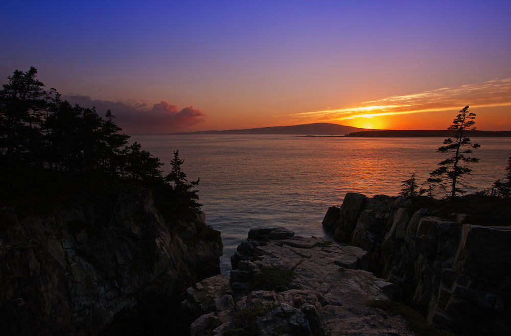 Coastal Maine seascape photography at sunset featuring a spectacular view across the beautiful cliffs at Schoodic Peninsula towards Cadillac Mountain in Maine Acadia National Park. This coastal spot is secretly tucked away in the much less crowded portion of the national park. The area is dramatic and unmarked and unpromoted by the national park for its steep and dangerous cliffs. I finally made a return journey to the only area of the national park that is located on main land. With tripod and camera positioned at the edge of the steep cliff in front of me I captured Cadillac Mountain Sunset.<br /> <br /> Acadia NP is a National Park located in the U.S. state of Maine. It reserves much of Mount Desert Island, and associated smaller islands, off the Atlantic coast. The park is one of the most visited wildlife areas in the United States and a paradise for every photographer and outdoor enthusiast. The park loop road provides easy access to many of the iconic photography subjects, such as Schoodic Peninsula, Monument Cove, Sand Beach, Jordan Pond and the Bubbles, Otter Cliff to name only a few. <br /> <br /> Maine Acadia National Park coastal photography images are available as museum quality photography prints, canvas prints, acrylic prints or metal prints. Prints may be framed and matted to the individual liking and room decor needs:<br /> <br /> http://fineartamerica.com/featured/cadillac-mountain-sunrise-juergen-roth.html<br /> <br /> Good light and happy photo making!<br /> <br /> My best,<br /> <br /> Juergen<br /> Licensing: http://www.rothgalleries.com<br /> Photo Prints: http://fineartamerica.com/profiles/juergen-roth.html<br /> Photo Blog: http://whereintheworldisjuergen.blogspot.com<br /> Instagram: https://www.instagram.com/rothgalleries<br /> Twitter: https://twitter.com/naturefineart<br /> Facebook: https://www.facebook.com/naturefineart