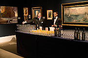POURING DRINKS, Preview of Greek Sale sponsored by Citibank. Sotheby's. New Bond st. London. 10 November 2008 *** Local Caption *** -DO NOT ARCHIVE -Copyright Photograph by Dafydd Jones. 248 Clapham Rd. London SW9 0PZ. Tel 0207 820 0771. www.dafjones.com