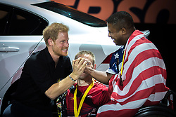 Prince Harry congratulates Ryan Major of the USA on his bronze medal in indoor rowing at the Invictus Games in Toronto, ON, Canada, on Tuesday, Sept. 26, 2017. Photo by Chris Donovan/CP/ABACAPRESS.COM