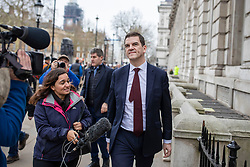 © Licensed to London News Pictures. 22/03/2019. London, UK. Chief Negotiator for Exiting the European Union Olly Robbins is asked questions by a broadcast journalist as he leaves the Cabinet Office in Westminster. The EU27 have agreed to Prime Minister Theresa May's request for a short extension to the deadline for leaving the European Union, offering two new deadlines depending on whether she is able to pass her deal next week. Photo credit: Rob Pinney/LNP