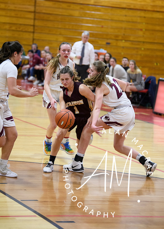 Lebanon sophomore Molly Smith drives past Hanover sophomore Melissa Whitmore  in the NHIAA Division II semi-final game at Pinterton Academy in Derry on Wednesday, March 11, 2020.  (Alan MacRae/Valley News)