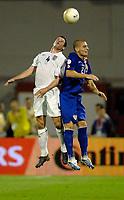 Photo: Richard Lane.<br />Croatia v England. UEFA European Championships 2008 Qualifying. 11/10/2006. <br />England's Jamie Carragher is challenged by Croatia's Miaden Petric.