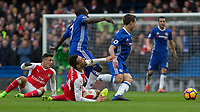 Football - 2016 / 2017 Premier League - Chelsea vs. Arsenal <br /> <br />  Francis Coquelin of Arsenal cries out in pain after Ngolo Kante of Chelsea treads on him at Stamford Bridge.<br /> <br /> COLORSPORT/DANIEL BEARHAM