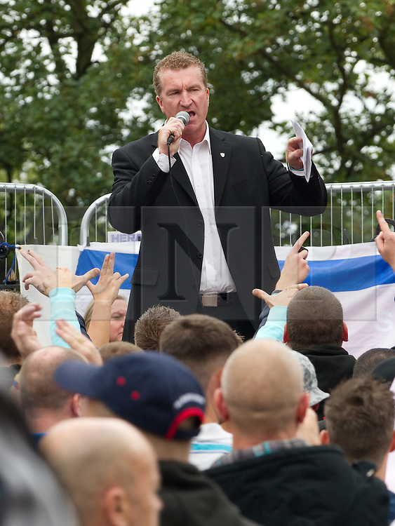 © Licensed to London News Pictures . FILE PICTURE DATED 13/08/2011 . The EDL deputy leader , KEVIN CARROLL (pictured at an EDL demonstration in Telford ) is to stand for the role of Police and Crime Commissioner , in Bedfordshire . The EDL leader , Stephen Yaxley-Lennon ( aka Tommy Robinson ) has announced he intends to turn the EDL in to a political party after quitting as a Vice Chairman of the British Freedom Party . Carroll (pictured), remains a Vice Chairman of the British Freedom Party . Photo credit : Joel Goodman/LNP