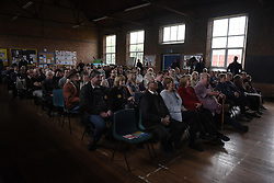 """© London News Pictures. """"Looking for Nigel"""". A body of work by photographer Mary Turner, studying UKIP leader Nigel Farage and his followers throughout the 2015 election campaign. PICTURE SHOWS - The audience listen intently during Nigel Farage's penultimate public meeting of his election campaign, at St Mark's Church Hall, Ramsgate. Kent, on May 2nd 2015. . Photo credit: Mary Turner/LNP **PLEASE CALL TO ARRANGE FEE** **More images available on request**"""