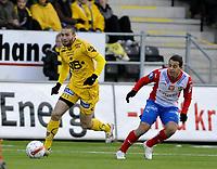 Fotball , 5. april 2009<br /> Tippeligaen<br /> Bodø/Glimt - FC Lyn<br /> Mounir Hamoud , Bodø/Glimt<br /> Diego Guastavino , Lyn<br /> Foto: Tor-Erik Eidissen , Digitalsport