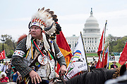 Shane Red Hawk of the Sicangu Lakota band of the Rosebud Sioux, and the Cowboy and Indian Alliance (CIA), a group of ranchers, farmers and indigenous leaders, prepare to march from the U.S. Capitol in Washington, District of Columbia, U.S., on Tuesday, April 22, 2014. The groups are hosting an encampment on the National Mall for a week's worth of actions against the Keystone XL tar sands pipeline.