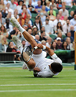 Lawn Tennis - 2021 All England Championships - Week Two - Friday - Wimbledon<br /> Mens Semi Final - Novak Djokovic v Denis Shapovalov<br /> <br /> Novak Djokovic falls at the net<br /> <br /> <br /> Credit : COLORSPORT/Andrew Cowie