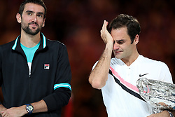 MELBOURNE, Jan. 28, 2018  Switzerland's Roger Federer(R) wipes his tear during the awarding ceremony of the men's singles final match against Croatia's Marin Cilic at Australian Open 2018 in Melbourne, Australia, Jan. 28, 2018. (Credit Image: © Bai Xuefei/Xinhua via ZUMA Wire)