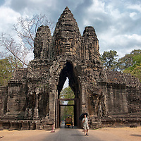 """Angkor Thom was the capital of the Khmer empire until 1295. Today the south gate is the main entrance for tourists. The Angkor Thom complex was featured in the """"Lara Croft"""" movie """"Tomb Raider"""", starring by Angelina Jolie."""