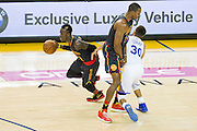 Atlanta Hawks center Dwight Howard (8) smashes Golden State Warriors guard Stephen Curry (30) with a screen as Atlanta Hawks guard Dennis Schroder (17) dribbles to the basket in the second quarter at Oracle Arena in Oakland, Calif., on November 28, 2016. (Stan Olszewski/Special to S.F. Examiner)