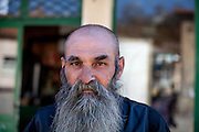 Portrait of a man in front of the local grocery store in the city of Crnik. Crnik has almost 90% of unemployment.