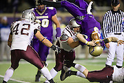 James Madison quarterback Drew Dudzik is upended on a fourth and one play during fourth quarter action at Bridgeforth Stadium in Harrisonburg in the NCAA Div 1-AA Semifinal Friday night. Montana beat JMU 35-27 to advance to the final in Chattanooga.