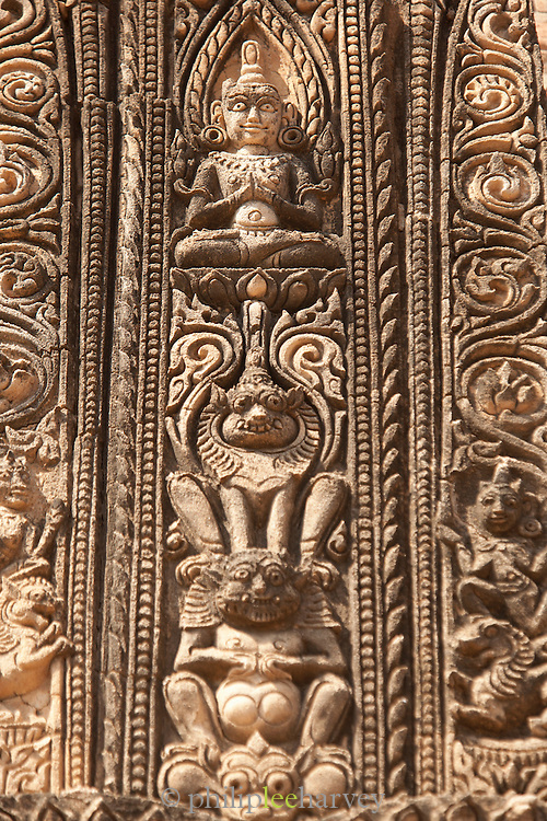 Stone carvings in the wall of a temple in the ancient city of Bagan, Myanmar