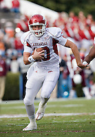 STARKVILLE, MS - NOVEMBER 22:   Nathan Dick #10 of the Arkansas Razorbacks runs with the ball against the Mississippi State Bulldogs at Davis Wade Stadium on November 22, 2008 in Starkville, Mississippi.  The Bulldogs defeated the Razorbacks 31 to 28.  (Photo by Wesley Hitt/Getty Images) *** Local Caption *** Nathan DickUniversity of Arkansas Razorback Men's and Women's athletes action photos during the 2008-2009 season in Fayetteville, Arkansas....©Wesley Hitt.All Rights Reserved.501-258-0920.