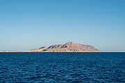 View of Tiran Island from a tour boat on the Red Sea, near Sharm el-Sheikh, Egypt.