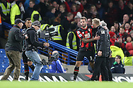 Steve Cook of Bournemouth puts his arm around Eddie Howe, the Bournemouth manager after the final whistle. Barclays Premier league match, Chelsea v AFC Bournemouth at Stamford Bridge in London on Saturday 5th December 2015.<br /> pic by John Patrick Fletcher, Andrew Orchard sports photography.