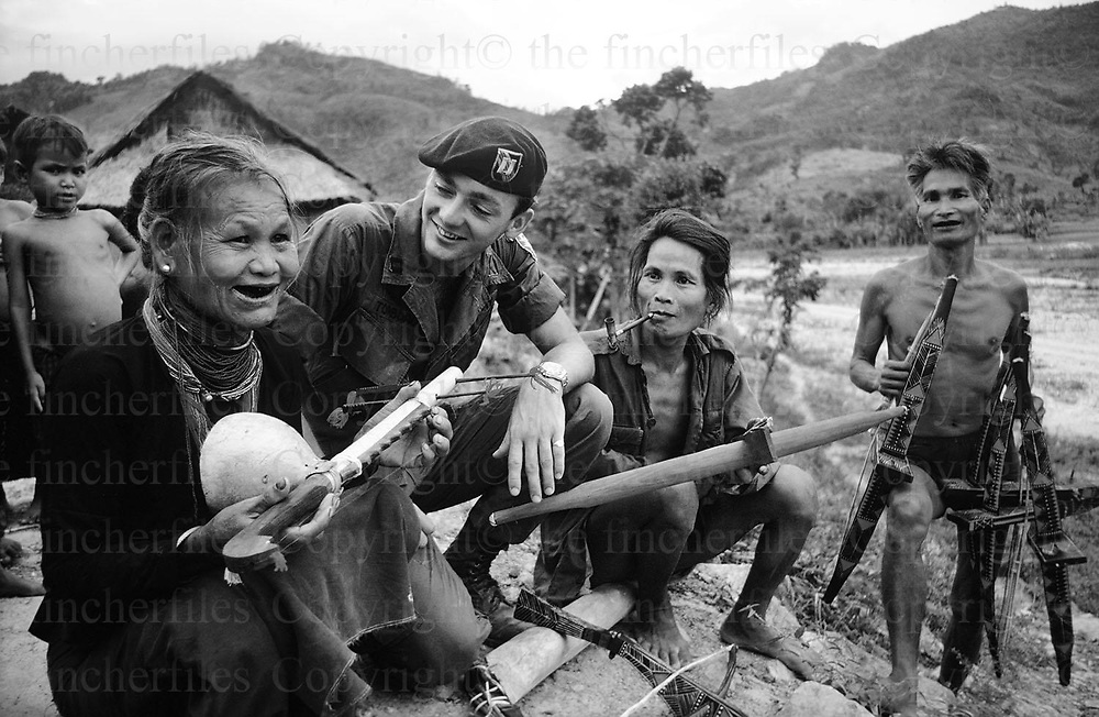 Soldier from the USA 101st Airborne Division seen with villagers of the Montagnards tribe in the Central Highlands of Vietnam. They are an indigenous tribe. Photograph by Terry Fincher 1969.