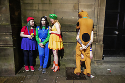 © Licensed to London News Pictures . 27/12/2018. Wigan, UK. Outside Reflex nightclub on King Street . Revellers in Wigan enjoy Boxing Day drinks and clubbing in Wigan Wallgate . In recent years a tradition has been established in which people go out wearing fancy-dress costumes on Boxing Day night . Photo credit: Joel Goodman/LNP