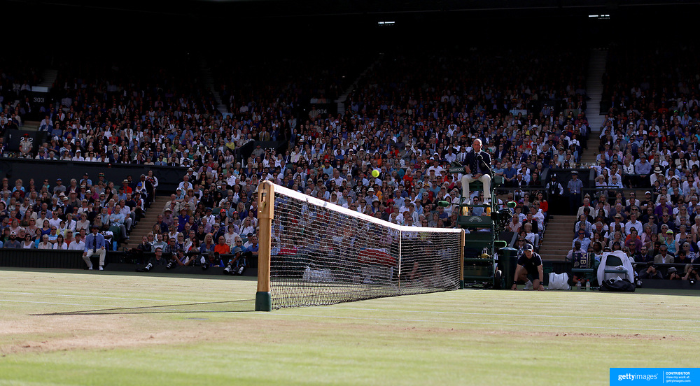 LONDON, ENGLAND - JULY 14: A general view of the Umpire watching the ball fly over the net on Center Court during of the Wimbledon Lawn Tennis Championships at the All England Lawn Tennis and Croquet Club at Wimbledon on July 14, 2017 in London, England. (Photo by Tim Clayton/Corbis via Getty Images)
