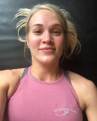 """Carrie Underwood releases a photo on Instagram with the following caption: """"When your face matches your shirt = you had a good workout! Unless your shirt is blue...then maybe you should be concerned! \ud83d\ude02 (sorry, total mom joke) \nI took these pics after my gym sesh yesterday (today I\u2019m cleaning this mess of a house, which I totally consider to be my Saturday workout). This is one of my favorite new outfits...I especially love the top because this is basically my motto these days! \ud83d\udcaa\n\nAnyway, just wanted to share! Sending out lots of weekend \u2764\ufe0f to you all! May we all get lots of stuff done and make a little time for ourselves in there, too!"""". Photo Credit: Instagram *** No USA Distribution *** For Editorial Use Only *** Not to be Published in Books or Photo Books ***  Please note: Fees charged by the agency are for the agency's services only, and do not, nor are they intended to, convey to the user any ownership of Copyright or License in the material. The agency does not claim any ownership including but not limited to Copyright or License in the attached material. By publishing this material you expressly agree to indemnify and to hold the agency and its directors, shareholders and employees harmless from any loss, claims, damages, demands, expenses (including legal fees), or any causes of action or allegation against the agency arising out of or connected in any way with publication of the material."""