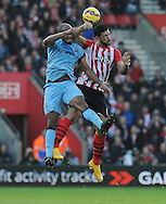 Graziano Pelle of Southampton is challenged by Vincent Kompany of Manchester City<br />  - Barclays Premier League - Southampton vs Manchester City - St Mary's Stadium - Southampton - England - 30th November 2014 - Pic Robin Parker/Sportimage