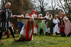 © Licensed to London News Pictures. 29/03/2013, London, UK.  Christains gather to re-enact the death of Jesus Christ in a Good Friday celebration in Epsom, south London, Friday, March 29, 2013. Photo credit : Sang Tan/LNP