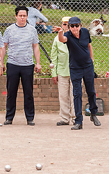 """© Licensed to London News Pictures. 05/06/2015.   London, UK. Monty Python star, Eric Idle, takes part in """"Freddie for the Day"""", by playing a special game of celebrity PÈtanque, competing for the Londonaise ëCelebrity PÈtanque Trophyí, ahead of The Londonaise PÈtanque festival this weekend in Barnard Park, Islington.  The festival will set a new precedent in the UK with 128 teams taking part in the main tournament.  The event also aims to raise funds for the Mercury Phoenix Trust to fight against AIDS worldwide. Photo credit : Stephen Chung/LNP"""