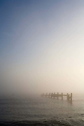 Broken sea defences in the early morning mist at Happisburgh, Norfolk, UK.