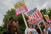 Women protestors outside a temporary perimeter fence encircling Winfield House, the official residence of the US Ambassador during the visit to the UK of US President, Donald Trump, on 12th July 2018, in Regent's Park, London, England.