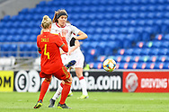 Wales Ladie's Sophie Ingle (4) battles for possession with Denmark Ladie's SofieJunge (13) during the Friendly match between Wales Women and Denmark Women at the Cardiff City Stadium, Cardiff, Wales on 13 April 2021.