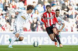 Ricardo Alvarez of Sunderland is challenged by Neil Taylor of Swansea City - Photo mandatory by-line: Rogan Thomson/JMP - 07966 386802 - 27/08/2014 - SPORT - FOOTBALL - Sunderland, England - Stadium of Light - Sunderland v Swansea City - Barclays Premier League.
