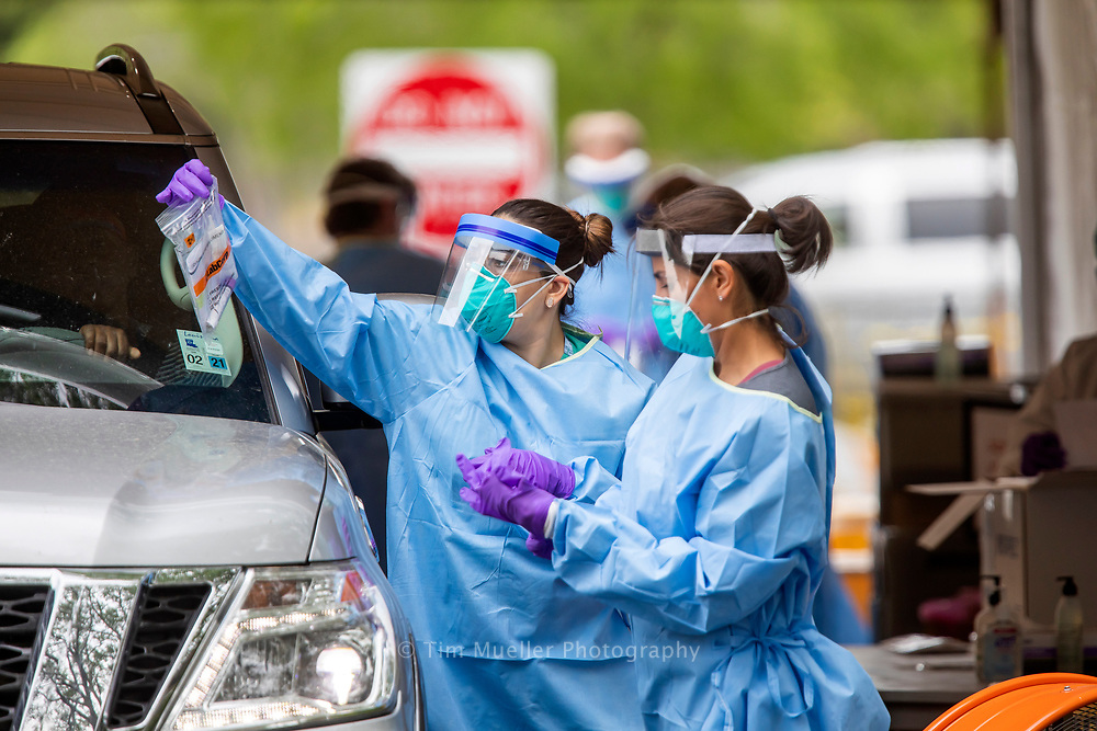 Doctors and nurses from Baton Rouge Clinic administer coronavirus testing Friday April 3, 2020 at the East Baton Rouge Parish COVID-19 drive-thru testing site at Baton Rouge General Mid City Hospital located at 3600 Florida Blvd. Residents with an approved provider order and a state issued ID remain in their vehicle as a clinician performs a nasal swap. On Friday approximately 150 residents were tested.
