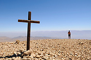 A wooden cross at the peak of a rocky mountain in Lebanon high above Bcharre. The Bekaa Valley and Syria are in the distance. (September 12, 2010)