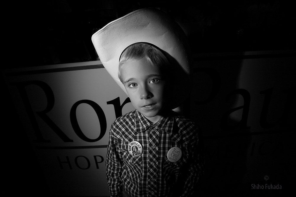 Robbie Robertson, 8, attends  U.S. Republican Presidential candidate Ron Paul's speech during his campaign stop in Des Moines, Iowa.