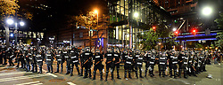 Charlotte officers in riot gear block the intersection near the Epicentre in Charlotte, NC, USA, on Wednesday, Sept. 21, 2016. The protestors were rallying against the fatal shooting of Keith Lamont Scott by police on Tuesday evening in the University City area. Photo by Jeff Siner/Charlotte Observer/TNS/ABACAPRESS.COM
