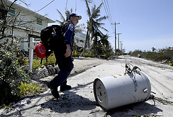 Los Angeles City Fire Department FEMA California Task Force 1 Firefighter Rudy Tucker goes around a electrical transformer brought down by Hurricane Irma as he canvases a community on Cudjoe Key, FL, USA, where Hurricane Irma's eye made landfall, on Tuesday, September 12, 2017. Photo by Taimy Alvarez/Sun Sentinel/TNS/ABACAPRESS.COM