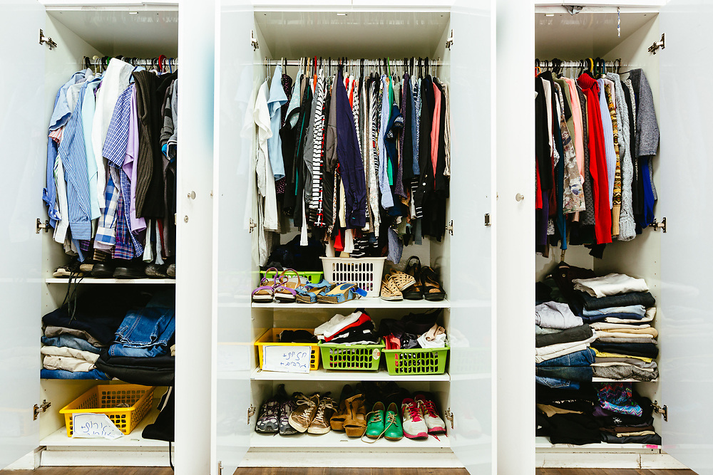 Second-hand clothes and shoes are seen inside a closet at the Hillel - The Right to Choose center in central Jerusalem, Israel, on November 25, 2019. Hillel - The Right to Choose is an Israeli non-profit organization dedicated to helping young adults who have left the ultra-Orthodox Jewish world integrate and lead successful lives as members of secular Israeli society.