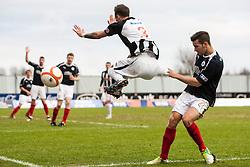 Dunfermline's Jordan McMillan jumps past Falkirk's Kieran Duffie..Falkirk 1 v 0 Dunfermline, 16/2/2013..©Michael Schofield.