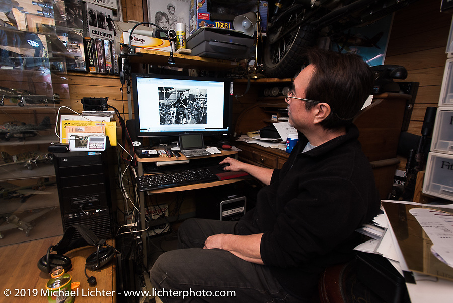 Keiji Kawakita shows us photos of his Harley racing father back in the day in his office at Hot Dock Custom Cycles. Japan. Wednesday, December 10, 2014. Photograph ©2014 Michael Lichter.