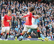 Marouane Fellaini of Manchester United fouls Sergio Aguero of Manchester City in the penalty area - Barclays Premier League - Manchester City vs Manchester Utd - Etihad Stadium - Manchester - England - 2nd November 2014  - Picture David Klein/Sportimage