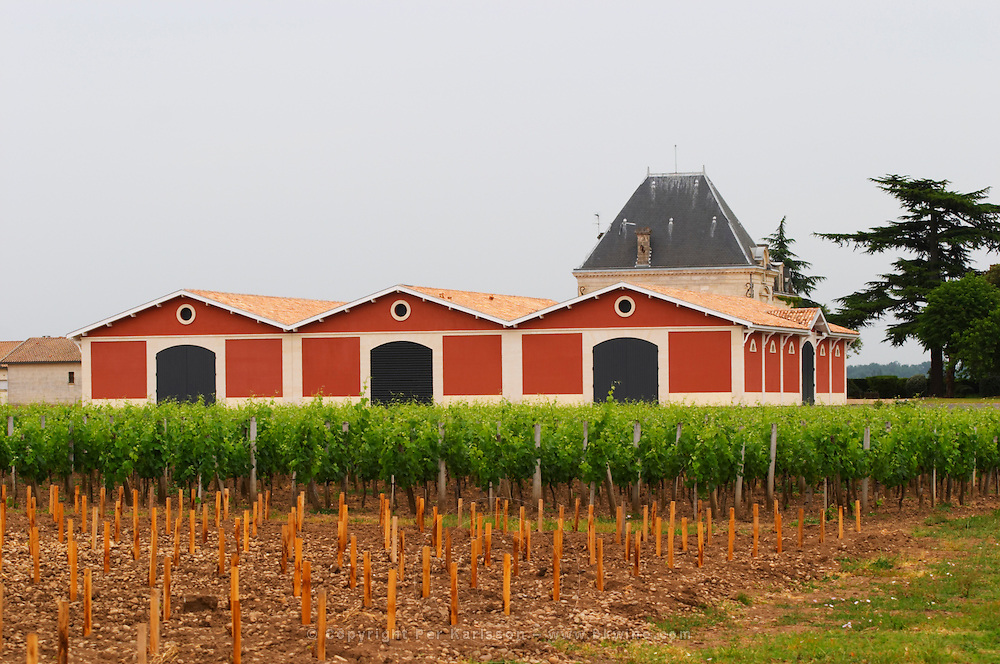 Chateau l'Evangile with its distinctive red winery building Pomerol Bordeaux Gironde Aquitaine France