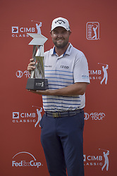 October 14, 2018 - Kuala Lumpur, Malaysia - Marc Leishman of Australia poses with the trophy after winning the CIMB Classic golf tournament in Kuala Lumpur, Malaysia on October 14, 2018. (Credit Image: © Zahim Mohd/NurPhoto via ZUMA Press)