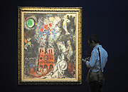 "© Licensed to London News Pictures. 14/06/2012. London, UK A man looks at Marc Chagall's ""L'Arbre de Jesse' estimated to fetch 3-5 MillionGBP. Photocall for Sotheby's June Impressionist and Modern Art Sale this June. Photo credit : Stephen Simpson/LNP"