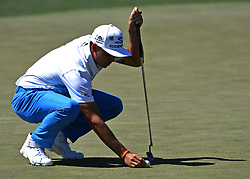 Rickie Fowler lines up his putt on the 2nd green during the third round of the Masters Tournament at Augusta National Golf Club in Augusta, Ga., on Saturday, April 8, 2017. (Photo by Jeff Siner/Charlotte Observer/TNS) *** Please Use Credit from Credit Field ***