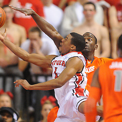 Rutgers Scarlet Knights guard Jerome Seagears (1) finishes his layup attempt after being fouled by Syracuse Orange center Baye Keita (12) during first half NCAA Big East basketball action between #2 Syracuse and Rutgers at the Louis Brown Athletic Center. Syracuse leads 40-34 at halftime.